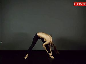 brunette gymnast displaying of her backside