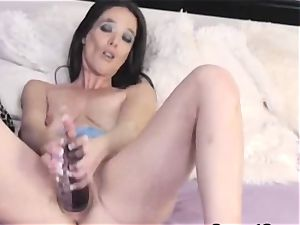 naughty stunner likes to play her two faux-cock