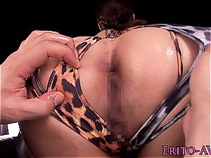 Lusty chinese gives a close sight of her unloading snatch