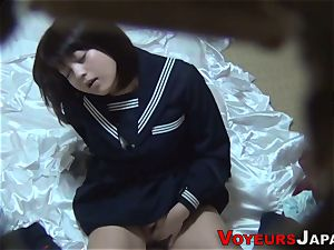 Uniformed chinese stunner caresses