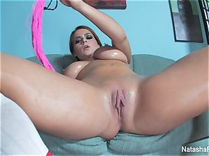 big-boobed Natasha lubes up her fun bags and plays with her labia