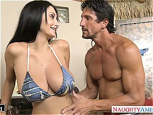 Ava Addams places his pink cigar between her gigantic jugs