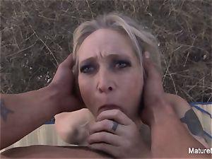 platinum-blonde mature inhales and nails outdoors