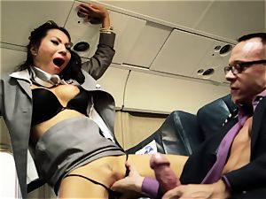 Asa Akira and her hostess mates pummel on flight