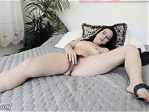 Juliette March plays with her wooly snatch